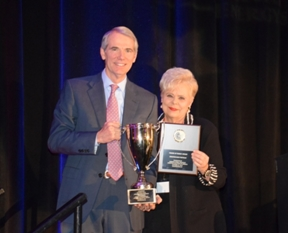 "Sen. Rob Portman receiving the Christian Coalition ""Friend of the Family"" Award from Christian Coalition CEO Roberta Combs after speaking at the Conservative Clean Energy Summit."